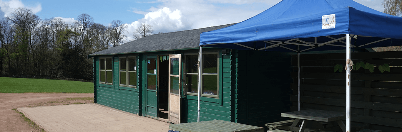 Green Chalet and Gazebo set up for event at Great Away Days in Edinburgh