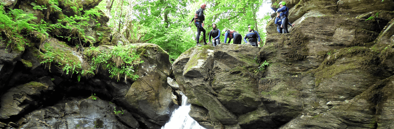 Stag group ready to jump into water when canyoning in Scotland