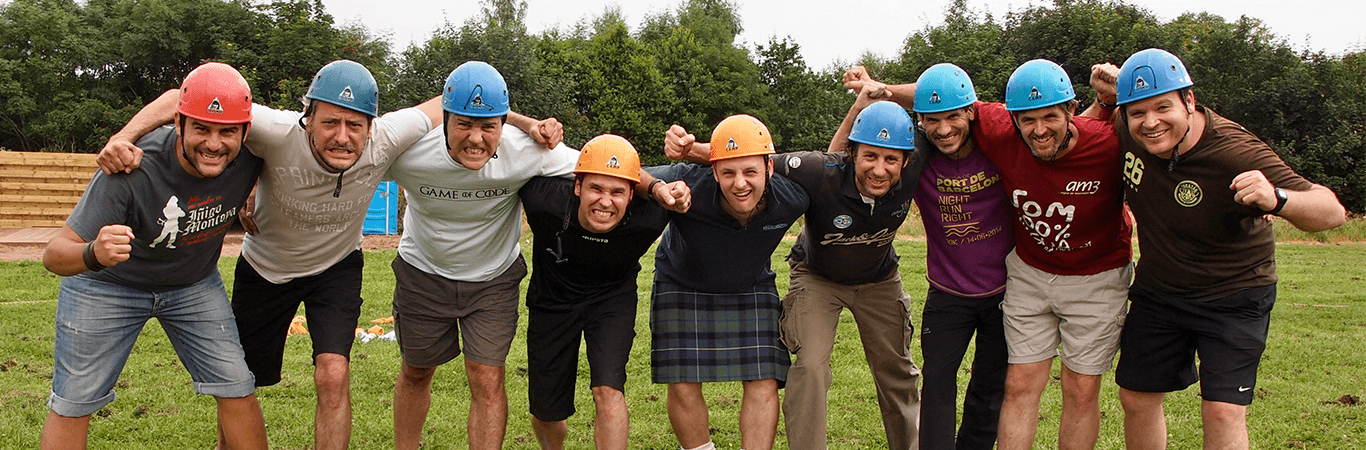 Stag group posing with instructor all in helmets after a Mini Highland Games in Edinburgh